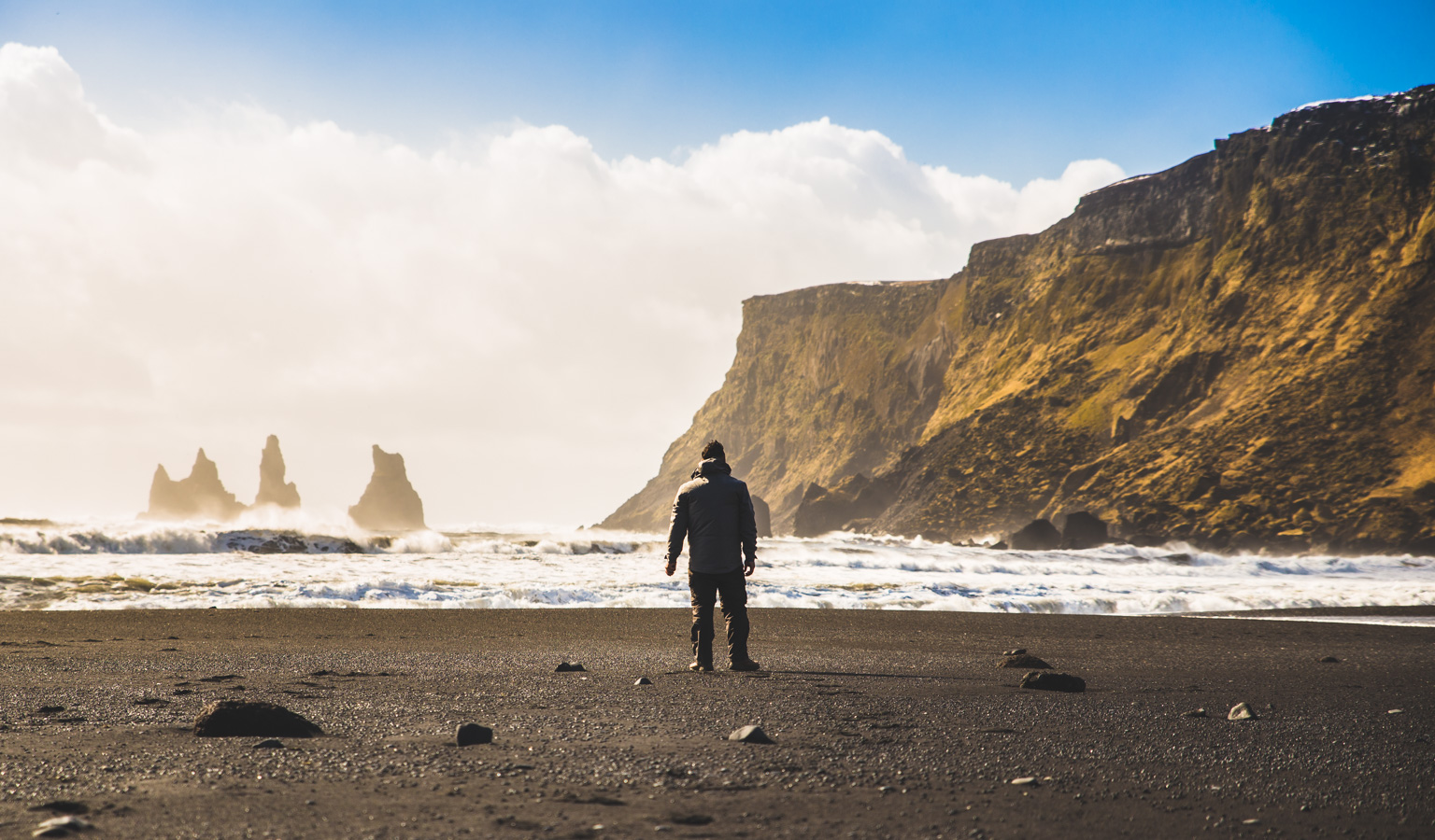 Exploring the black sand beaches at Vík, Iceland